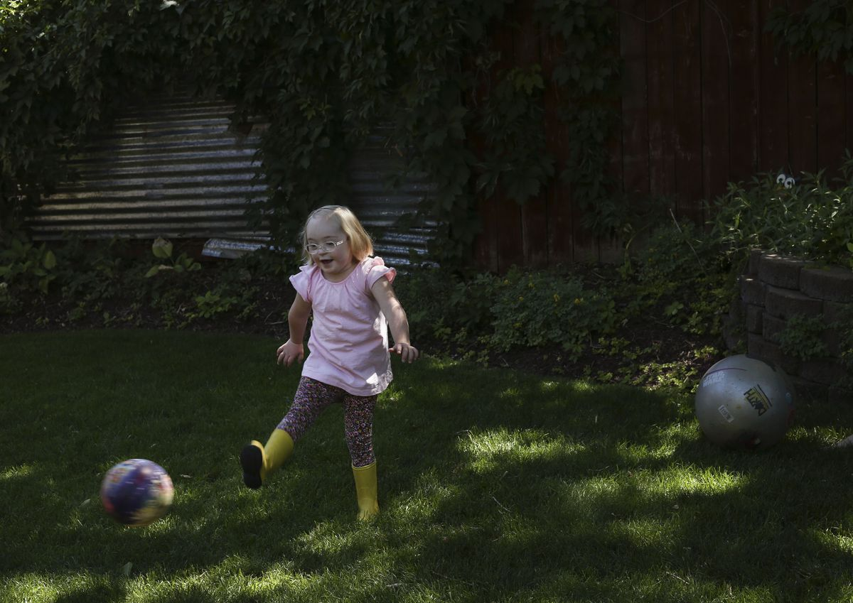Tori Longwell, who will be a first grader at Highland Park Elementary School, plays kickball at her home in Salt Lake City on Wednesday, July 29, 2020. The Longwells have decided as a family to return to remote learning this fall due to risks to Tori, who has Down syndrome, but also to the rest of the family.