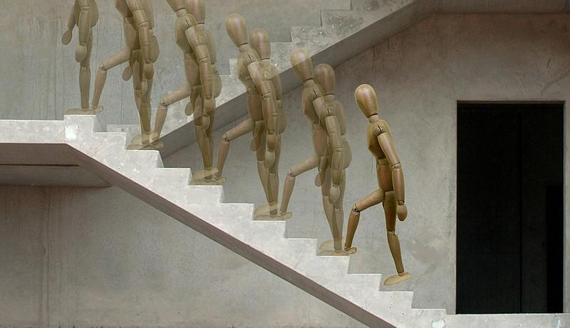 Stickman demonstrates the Alternating Stair Climb. (Arkansas Democrat-Gazette/Celia Storey)