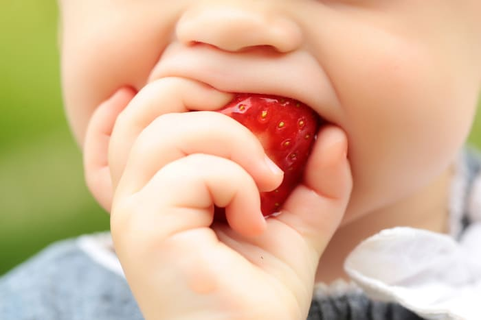 You can start your baby on solid foods at six months, but don't expect them to eat much(Photo: Adobe. Do not use without permission)