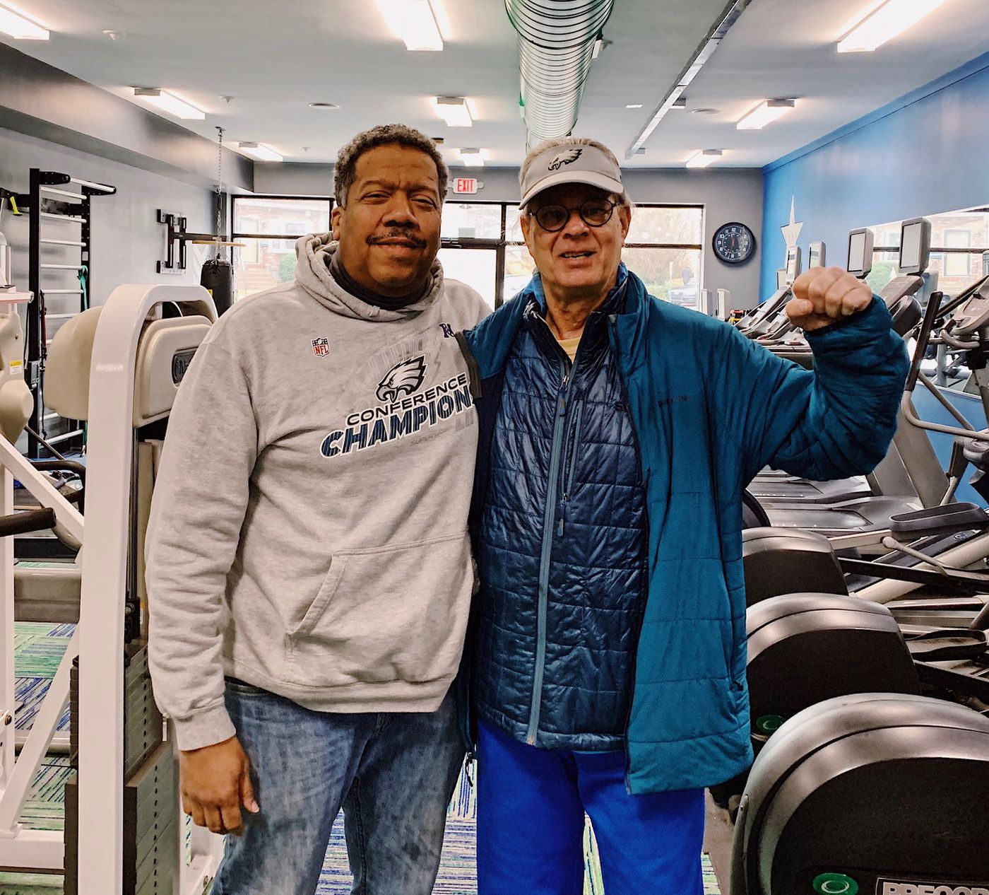 FItness trainer Lance Jones, left, with his high school track coach and biology teacher, Crawford Hill.