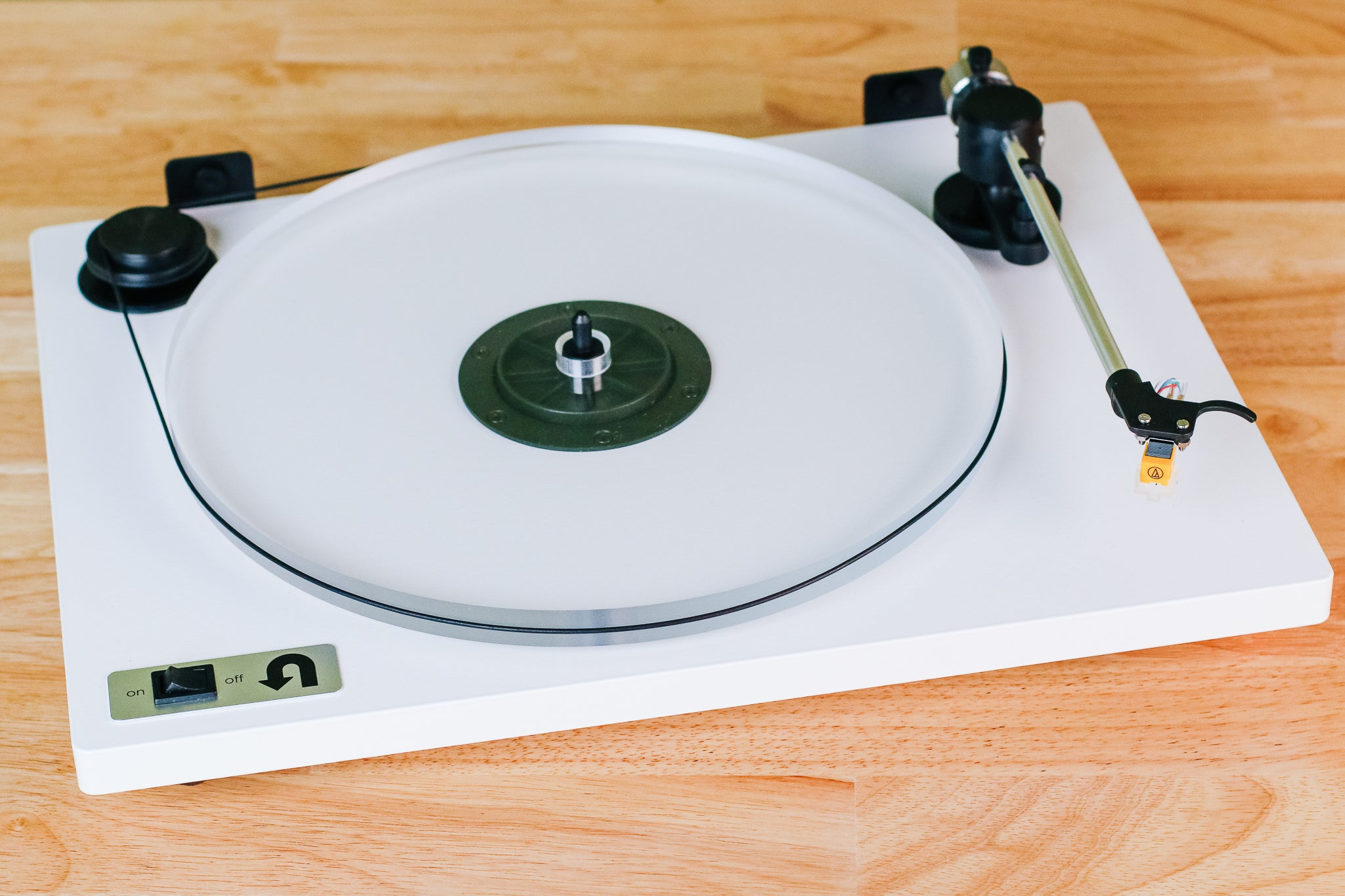 The U-Turn Orbit Basic record player, shown on a wooden surface.